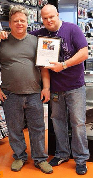 photo of game start stores founder Michael Elliott with one of his video game store set up client, Jack Wells